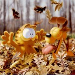 Garfield And Odie Playing With Leaves Wallpaper